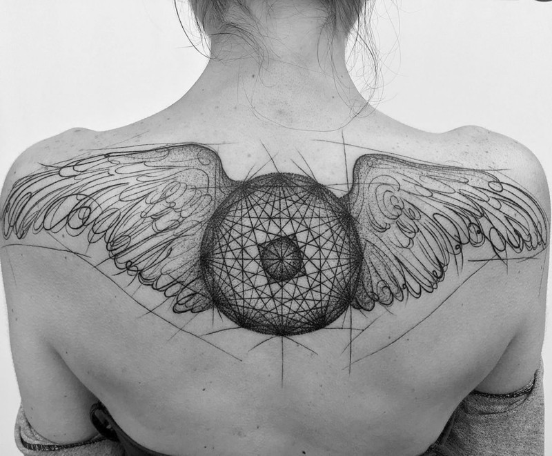 Black ink unfinished big upper back sketch tattoo of mystic circle with wings