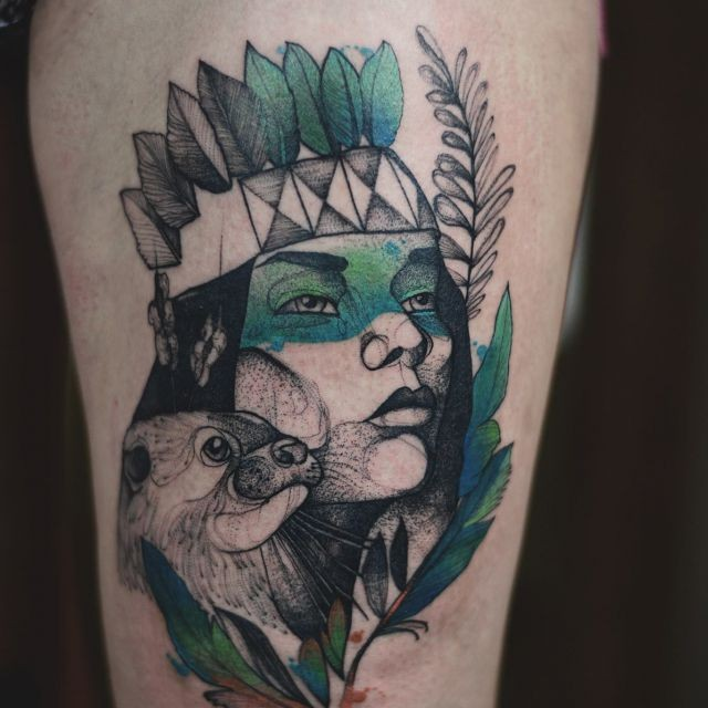 Black ink upper arm tattoo painted by Joanna Swirska of Indian woman with small animal