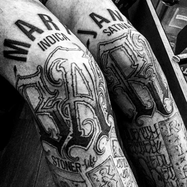 Black ink various styles lettering tattoo on legs