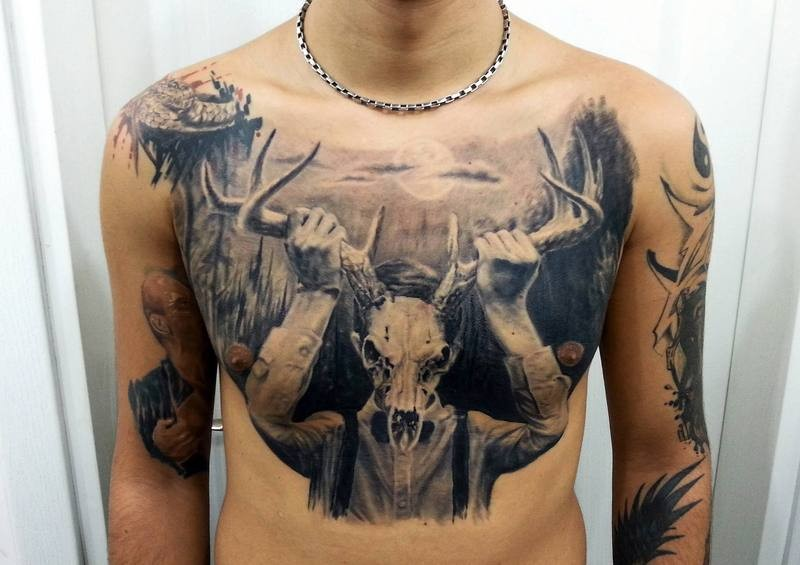 Black Ink Very Detailed Chest Tattoo Of Mystical Man With