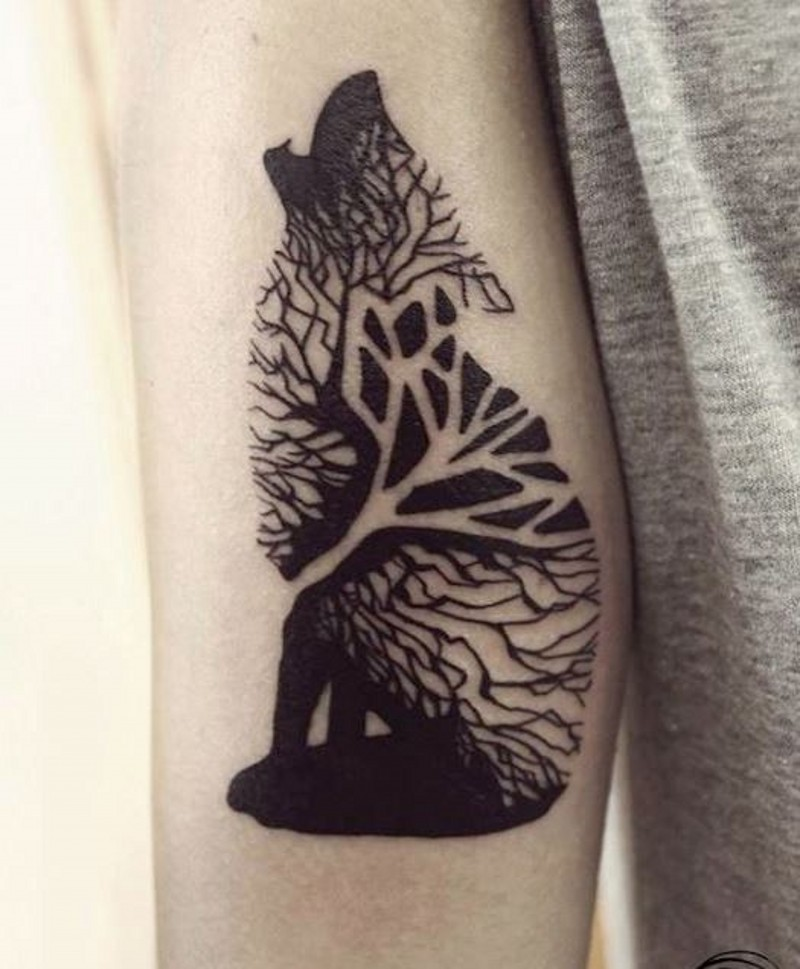 Black ink wolf consisting of wood tattoo on arm for Black tattoo ink