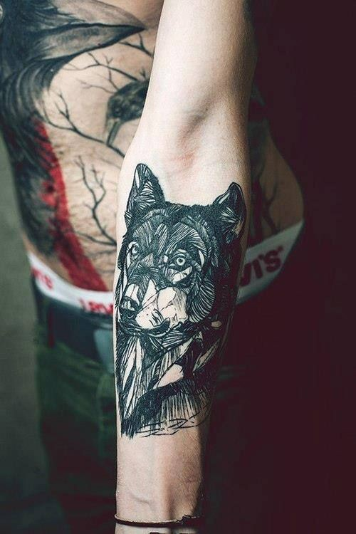 Black ink wolf forearm tattoo