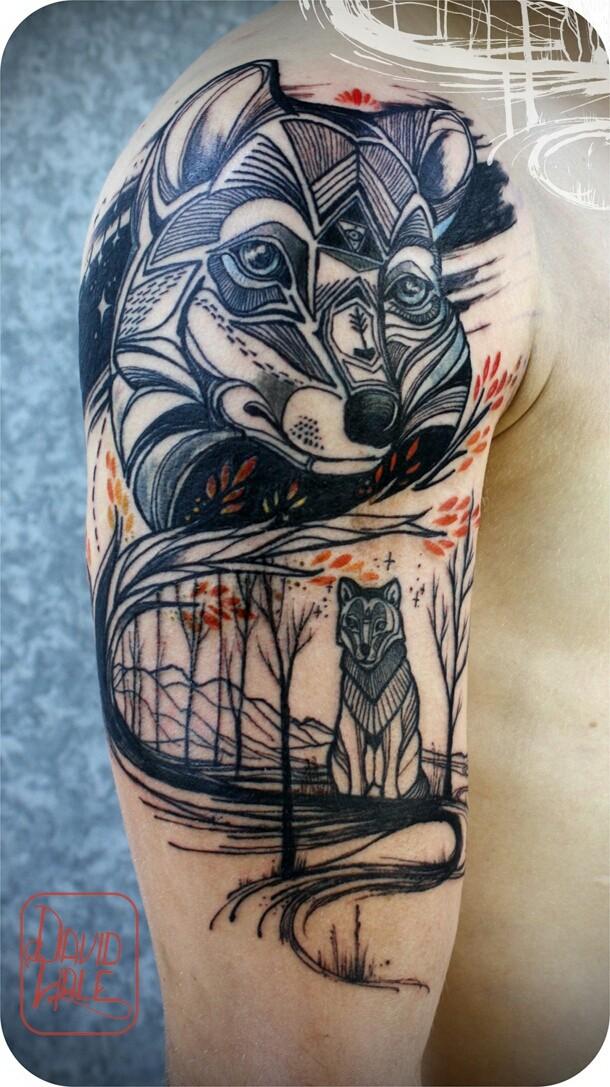 lupi nel bosco inchiostro nero tatuaggio avambraccio