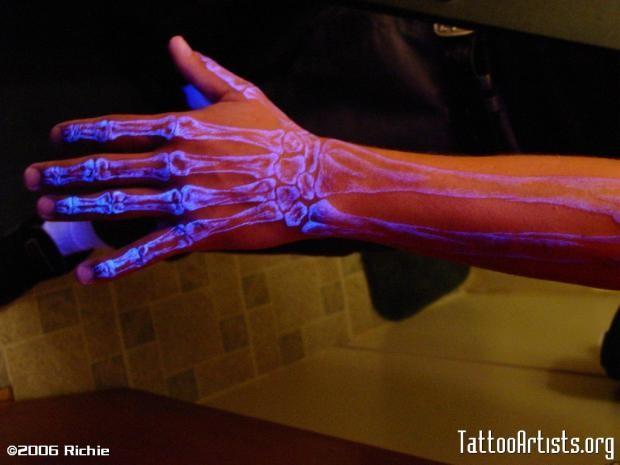 Black light hand of skeleton tattoo
