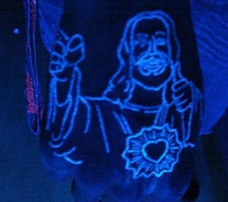 Black light jesus tattoo on the fist