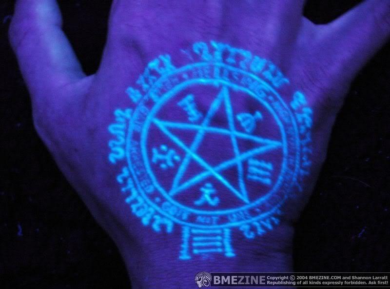 Black light pentagram on the palm