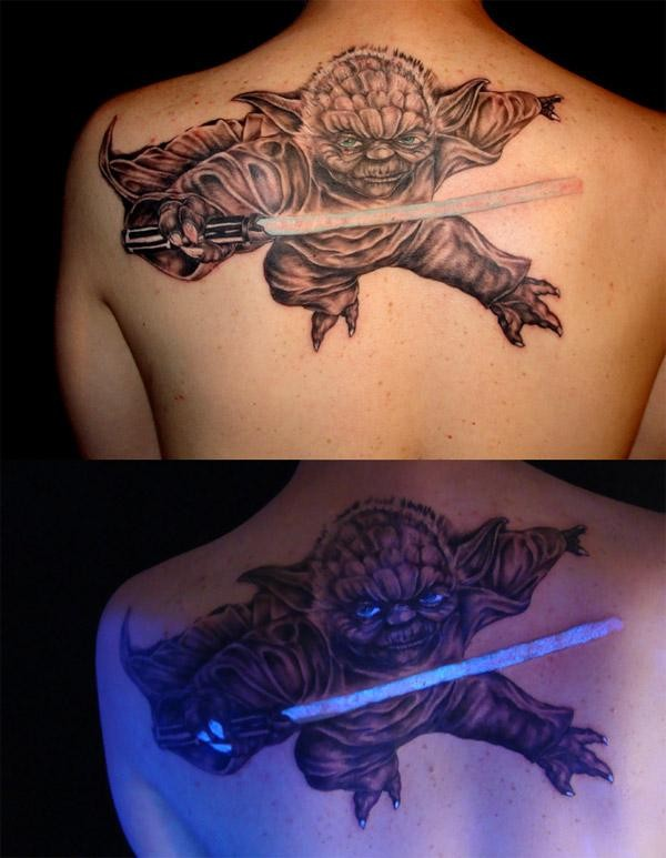 Black light tattoo yoda and sword of the jedi