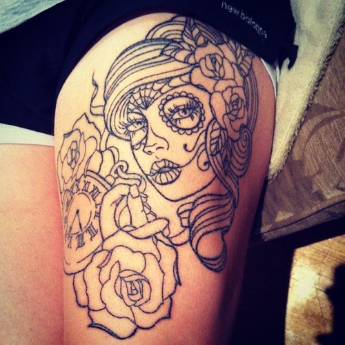 Black lines dia de los muertos tattoo on thigh