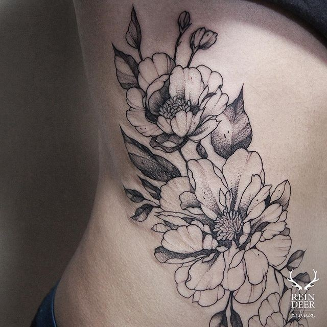 Black outline style designed by Zihwa side tattoo of flowers with big leaves