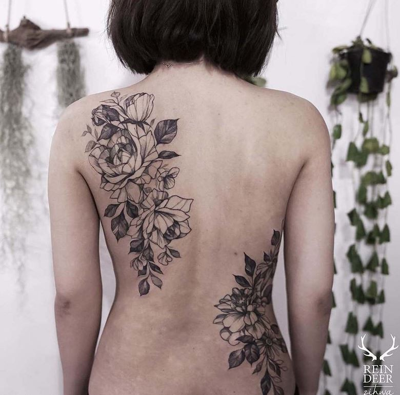 Black outline style painted by Zihwa back tattoo of flowers with leaves