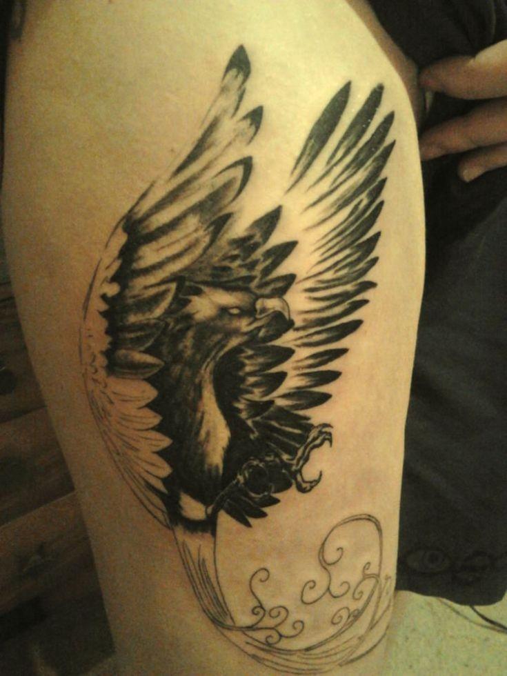 Black phoenix tattoo on leg