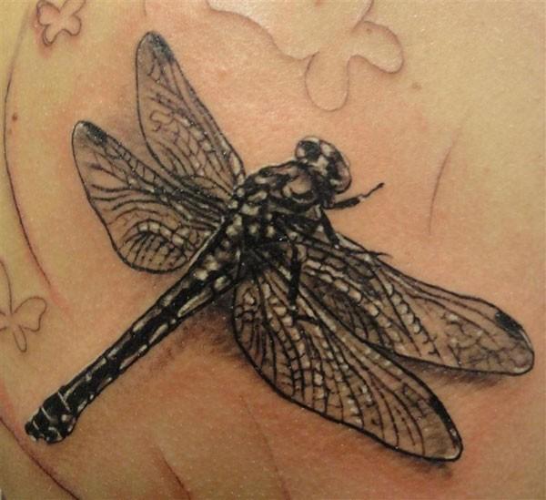 Black realistic dragonfly tattoo