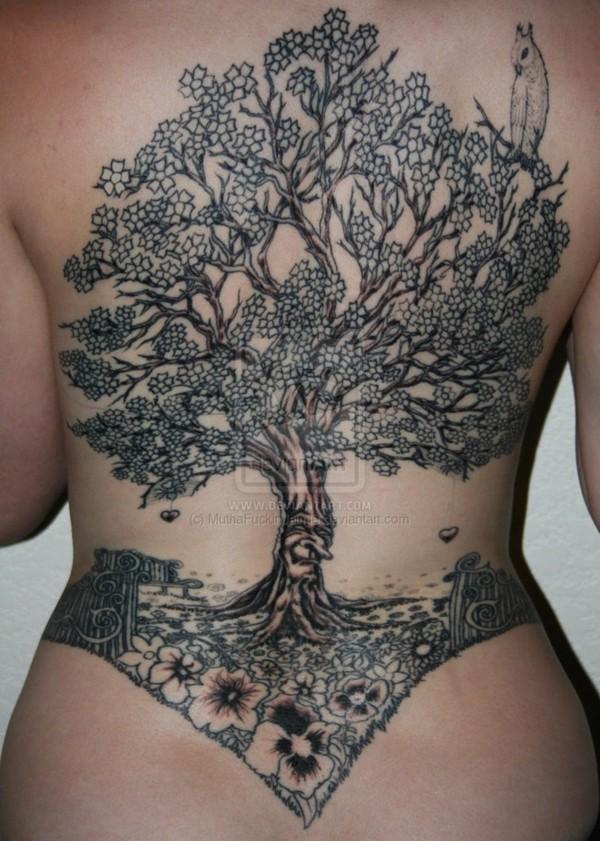 Black stylized tree and flowers tattoo on whole back
