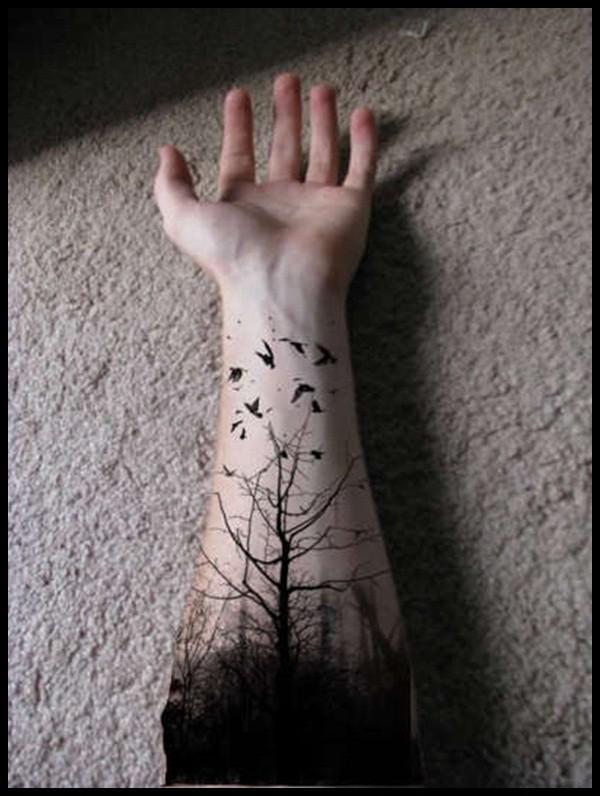 Tatuaggio simpatico sul braccio la foresta