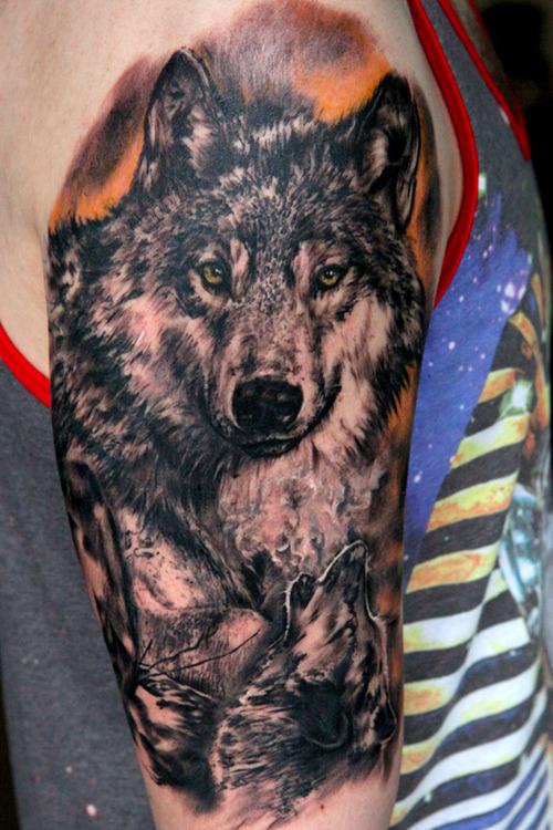 Black wolves on his shoulder