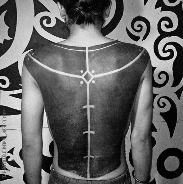 Black work style large ornaments tattoo on back