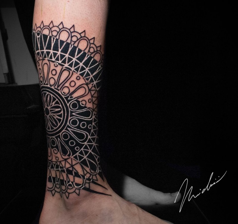 Black work with geometric stuff tattoo