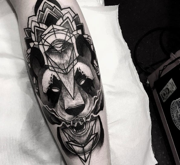 Blackwork creative looking leg tattoo of demonic bear with floral ornaments