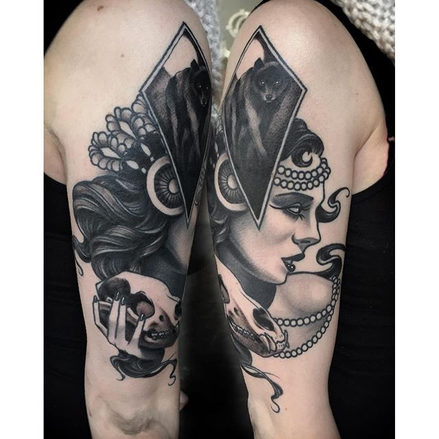 Blackwork modern style upper arm tattoo of woman portrait with animal skull by Michael J Kelly