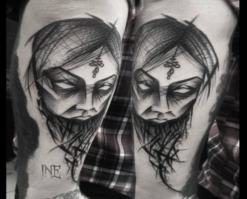 Blackwork style amazing looking arm tattoo of woman mask by Inez Janiak