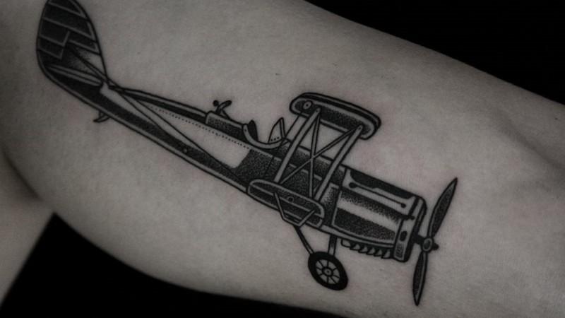 Blackwork style amazing looking tattoo of vintage plane