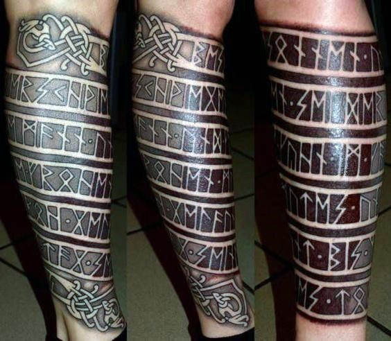 Blackwork style ancient Celtic lettering tattoo on leg