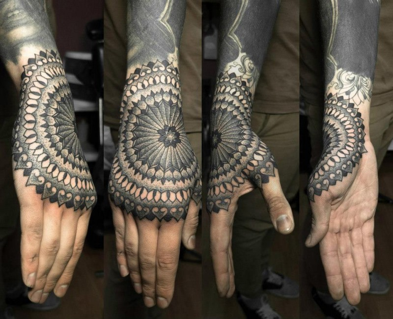 Blackwork style big forearm and hand tattoo of ornamental flower