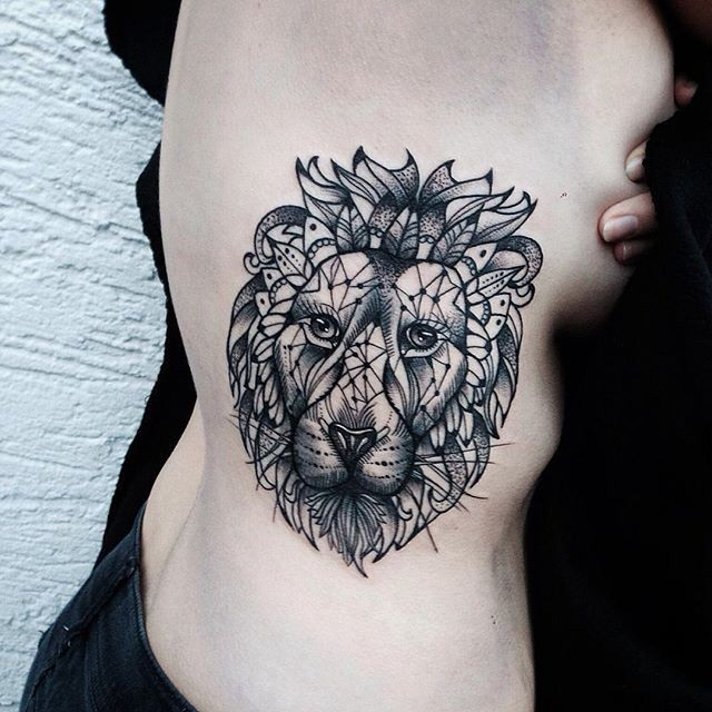 Blackwork style big side tattoo of lion head with various figures