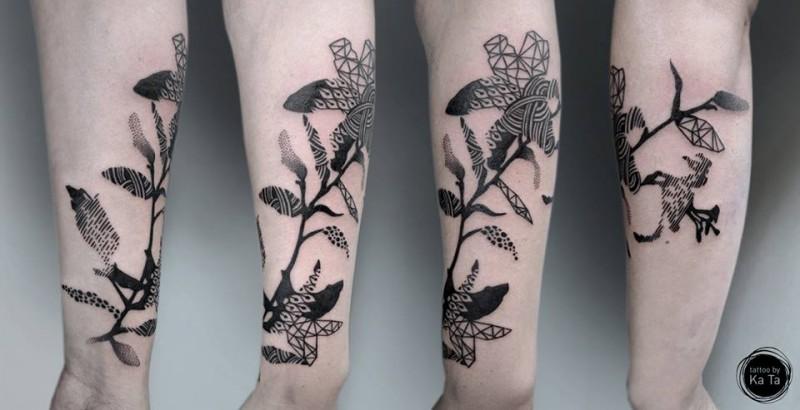 Blackwork style colored forearm tattoo of big flower