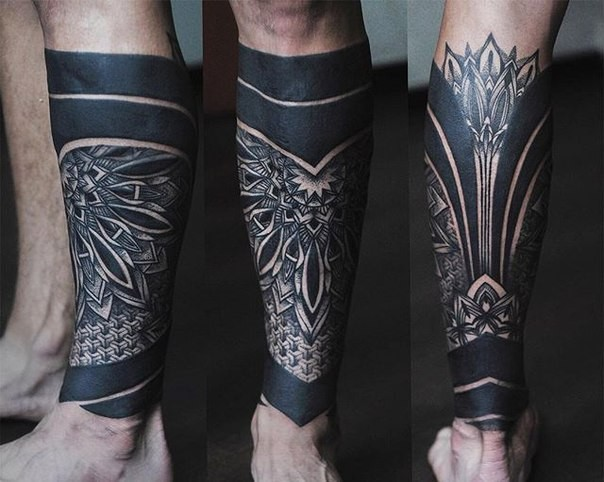 Blackwork style colored leg tattoo stylized with ornamental flowers