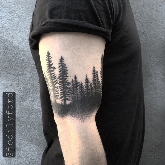Blackwork style detailed biceps tattoo of deep forest