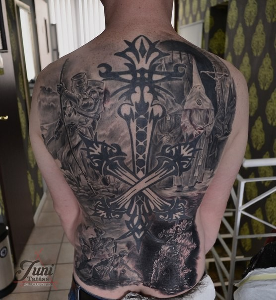 Blackwork style detailed whole back tattoo of various mystical figures with cross