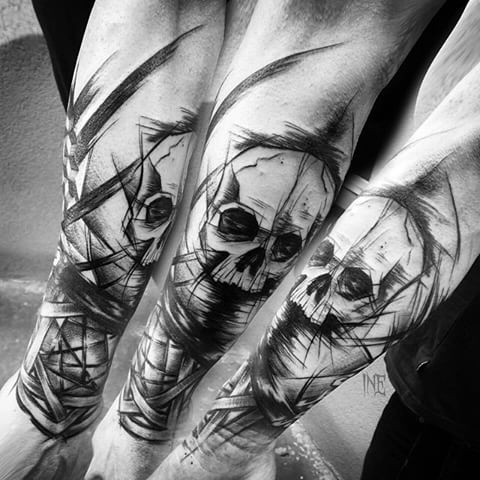 Blackwork style forearm tattoo of human skull
