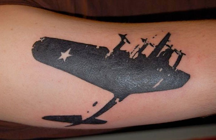 Blackwork style incredible looking tattoo of WW2 bomber plane