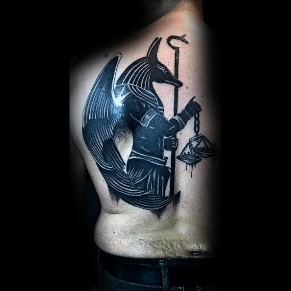 Blackwork style large back tattoo of Anubis God