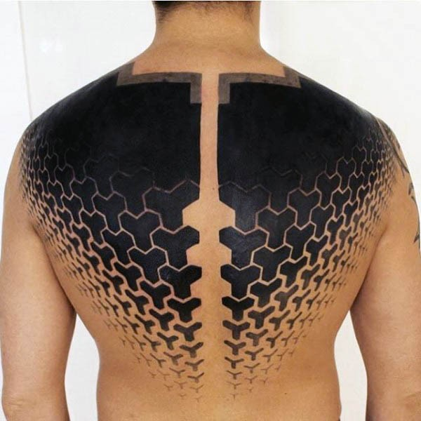 Blackwork style large ornaments tattoo on back and shoulders