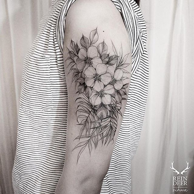 Blackwork style large painted by Zihwa tattoo of nice wildflowers
