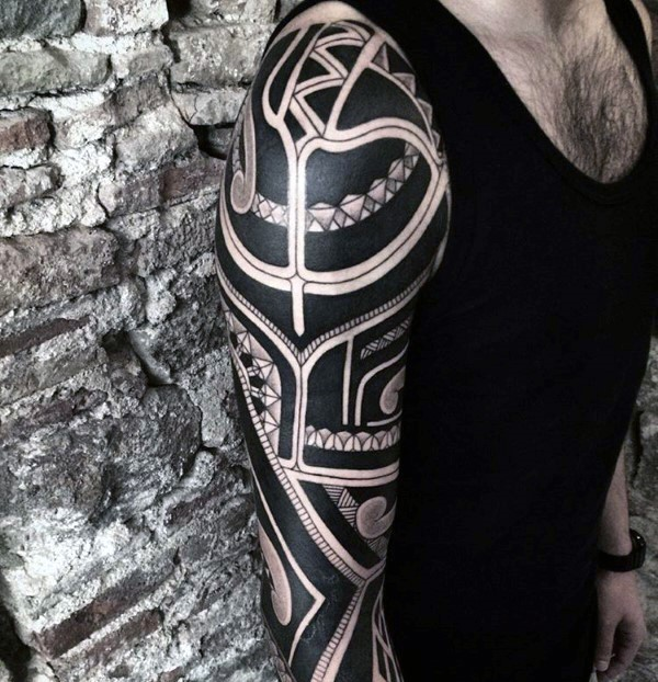 Blackwork style large sleeve tattoo of Polynesian ornaments
