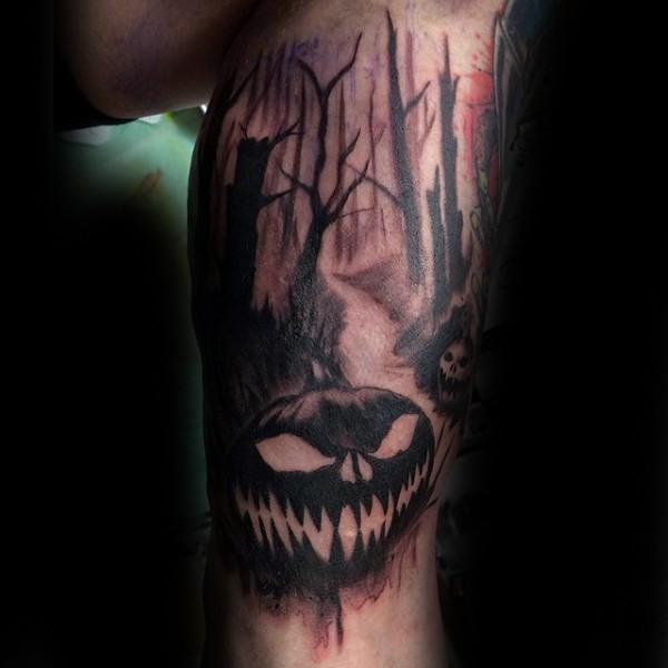 Blackwork style leg tattoo of dark forest with pumpkins