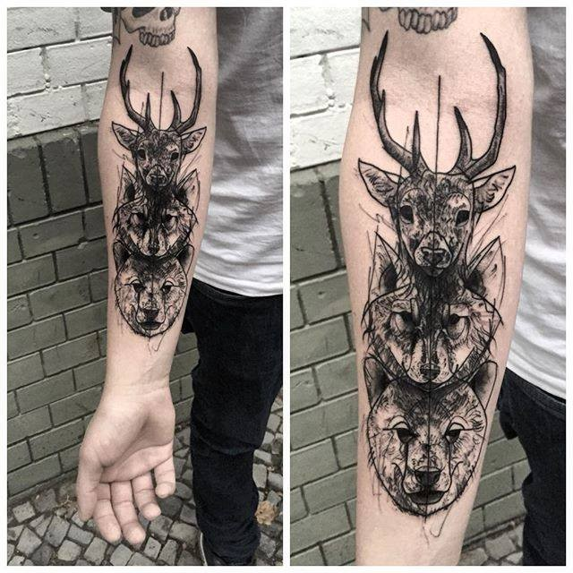 Blackwork style medium size forearm tattoo of various animals heads