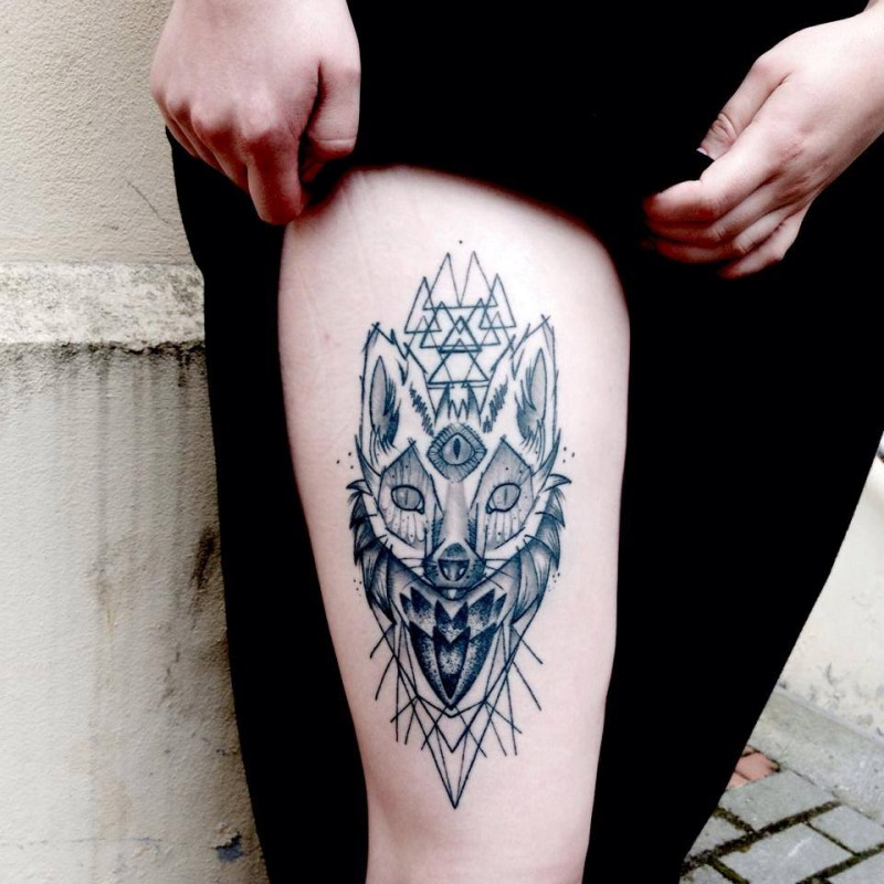 Blackwork style mystical cat with triangles tattoo on thigh