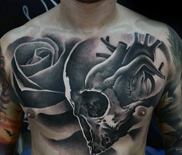 Blackwork style nice looking chest tattoo of human skull combined with rose and heart