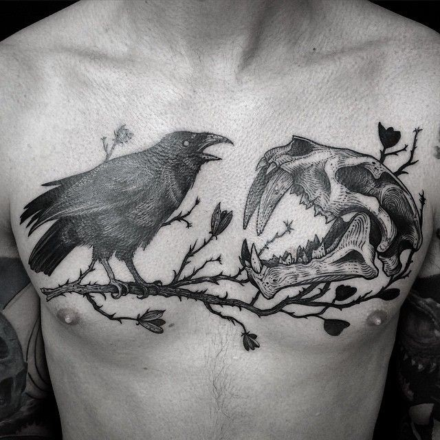Blackwork style nice looking chest tattoo of crow with animal skull by Dino Nemec