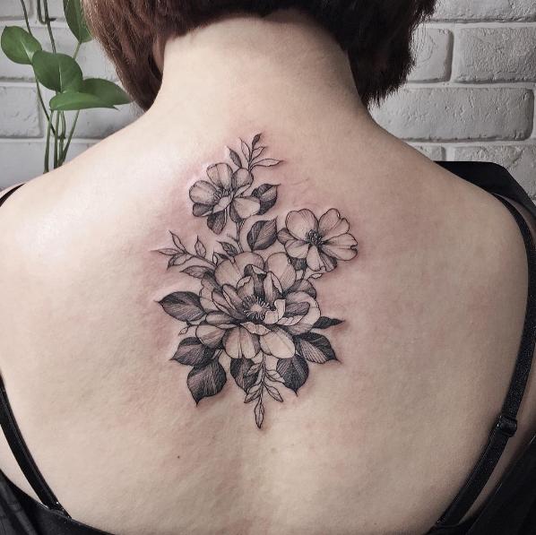 Blackwork style nice looking flowers tattoo by Zihwa