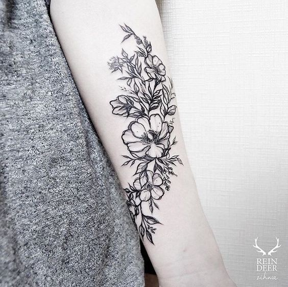 Blackwork style nice painted by Zihwa forearm tattoo of wildflowers
