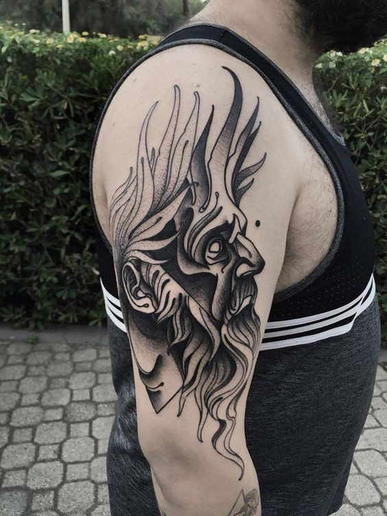 Blackwork style painted by Michele Zingales upper arm tattoo of mysterious man