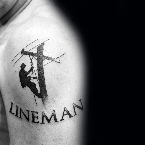 Blackwork style simple looking shoulder tattoo of lineman with lettering