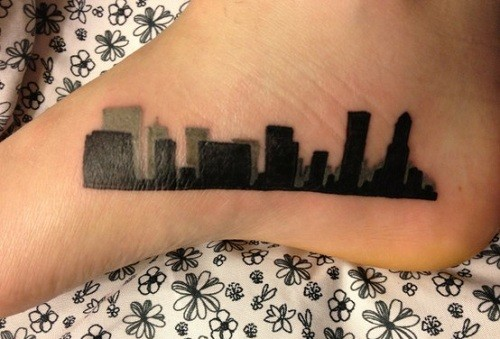 Blackwork style simple small foot tattoo of city sights