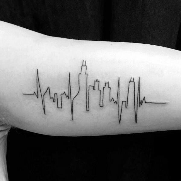 Blackwork style small city shaped forearm tattoo