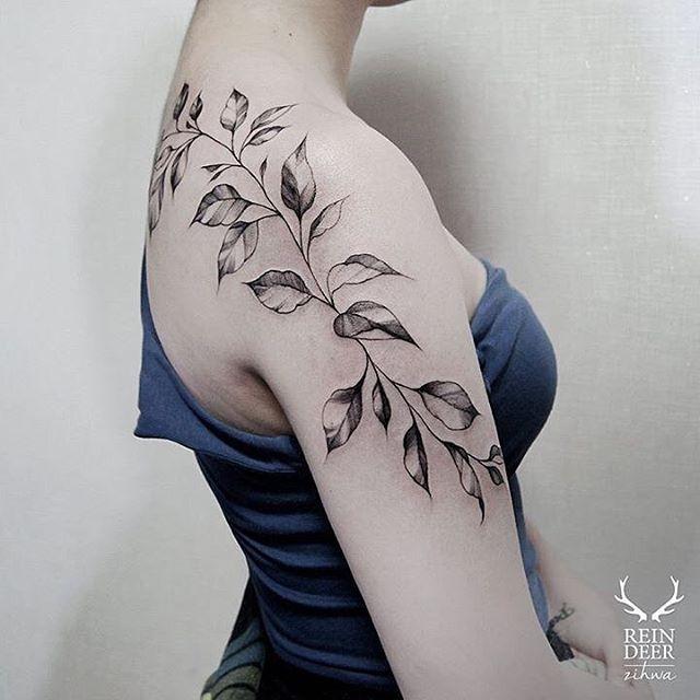 Blackwork style usual looking painted by Zihwa shoulder tattoo of leaves vine